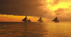 Beautiful marine sea scape of floating sail boats at sunset with dramatic sky - stock footage