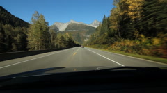 POV driving in the Rocky Mountains with autumn colours. British Columbia. Stock Footage