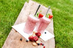 Stock Photo of Fruity berry milkshake outdoors