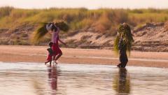 Stock Video Footage of Burmese citizens of rural Myanmar near Bagan historical site carry load walking