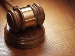Judge gavel on wooden background Stock Photos