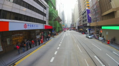 Time lapse video from famous Hongkong tram moving through busy city at day time - stock footage