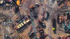 Time lapse video of construction activity. Cranes, trucks, workers and equipment Stock Footage