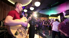 Rockabilly music band performs on a stage - stock footage