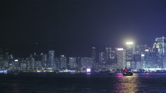 Beautiful night panorama of Hong Kong Victoria harbor with many modern buildings Stock Footage
