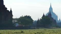 Amazing landscape of Bagan site in Burma. Silhouettes of old Buddhist Pagodas Stock Footage