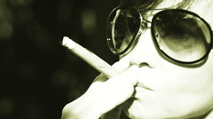 Close-up view of woman face smoking cigar, slow motion video  - stock footage