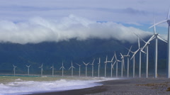 Many wind mill turbines along sea coast generate eco friendly energy - stock footage