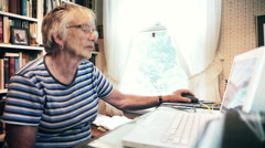 Senior Woman Using Computer for Online Live Video Chat at Home - stock footage