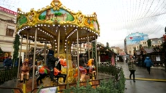 Christmas fair and carousel at Kuznetsky Most street. - stock footage