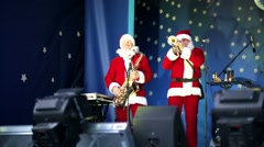 Santas musicians perform during public christmas festival Stock Footage