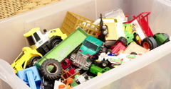 Toys for boys in a box with toy cars etc   4K Stock Footage
