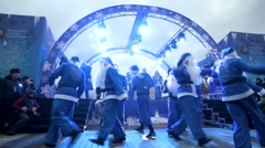 Many Santas dance during christmas flash mob at Manezhnaya square. - stock footage