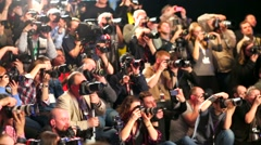 Photographers crowd shoot models on a catwalk Stock Footage