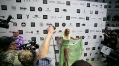 Prima ballerina Anastasia Volochkova pose for photographers Stock Footage