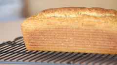 Freshly Baked Bread on a Cooling Rack Stock Footage
