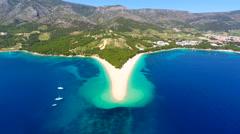 Aerial view of Zlatni Rat beach in Bol on island of brac, Croatia. Stock Footage