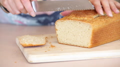 Slicing Freshly Baked Bread on a Cutting Board Stock Footage