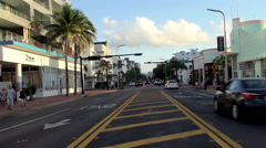 Road traffic on Collins Avenue at Miami Beach Art Deco District. Stock Footage