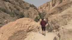 Hiker in Ein Gedi, Israel - stock footage