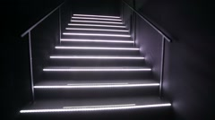 Walking by stairs in a nightclub. Stock Footage