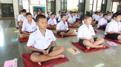 Stock Video Footage of Thai student Meaning meditation.