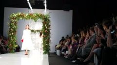 Spectators watch models catwalk for Yulia Prokhorova collection - stock footage