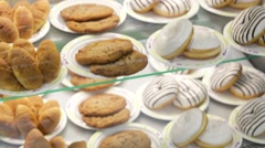 Biscuits muffins and donuts Stock Footage