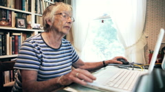 Senior Woman Using Computer Internet Technology to do Online Shopping at Home Stock Footage
