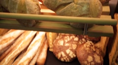 Fresh crisp breads at the bakery counter. - stock footage