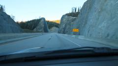 Driving through giant rockcut in the Rocky Mountains, BC, Canada. - stock footage