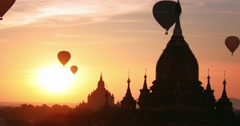 Hot air balloons flying over ancient Buddhist temples in historical site Stock Footage