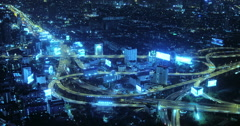 Futuristic cityscape background of modern highway interchange system at night Stock Footage