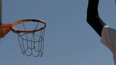 Scoring a basket in a basketball hoop. - stock footage
