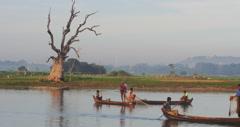 Burmese fishermen from local village near U Bein bridge fishing in Irrawaddy - stock footage