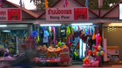 Stock Video Footage of Shops at Nopparat Thara Beach, Aonang, Thailand