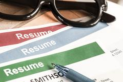 Resume letter background and glasses, pen, can use as recruitment business co - stock photo