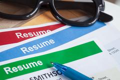 Resume letter background and glasses, pen, can use as recruitment business co Stock Photos