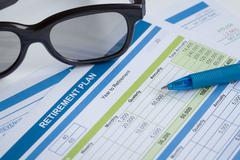 Retirement Planning with glasses and pen, business concept - stock photo