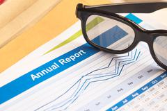 Annual Report letter document and eyeglass Stock Photos