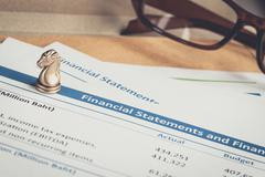 Financial statement letter on brown envelope and eyeglass, business concept;  Stock Photos