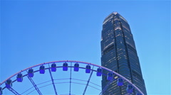 Hong Kong ferris wheel with International Finance Centre building Stock Footage