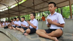 Thai student chant buddhism. Stock Footage