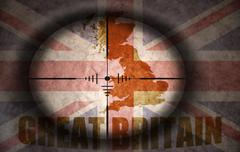 sniper scope aimed at the vintage great britain flag and map - stock illustration