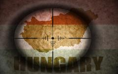 Sniper scope aimed at the vintage hungarian flag and map Stock Illustration