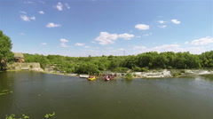 River and tourists with boats for  alloy. Aerial view Stock Footage