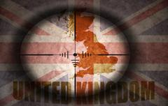 sniper scope aimed at the vintage united kingdom flag and map - stock illustration