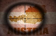 sniper scope aimed at the vintage austrian flag and map - stock illustration