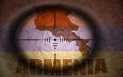 Stock Illustration of sniper scope aimed at the vintage armenian flag and map