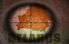 Sniper scope aimed at the vintage belarus flag and map Stock Illustration